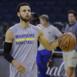 Golden State Warriors' Stephen Curry dribbles during an NBA basketball practice, Wednesday, May 31, 2017, in Oakland, Calif. The Golden State Warriors face the Cleveland Cavaliers in Game 1 of the NBA Finals on Thursday in Oakland. (AP Photo/Marcio Jose Sanchez)