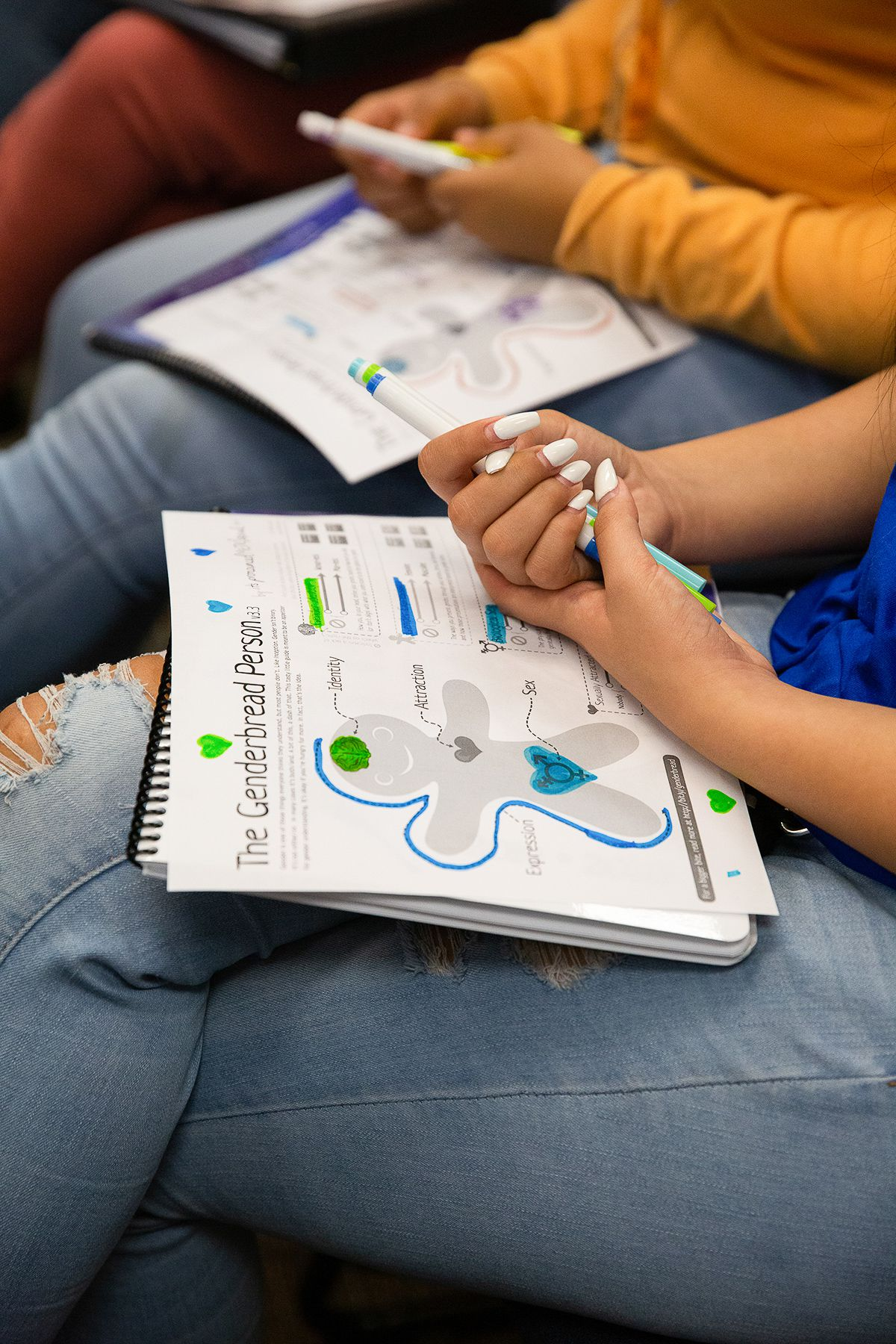 "A worksheet titled ""The Genderbread Person"" is seen in a high school student's lap."
