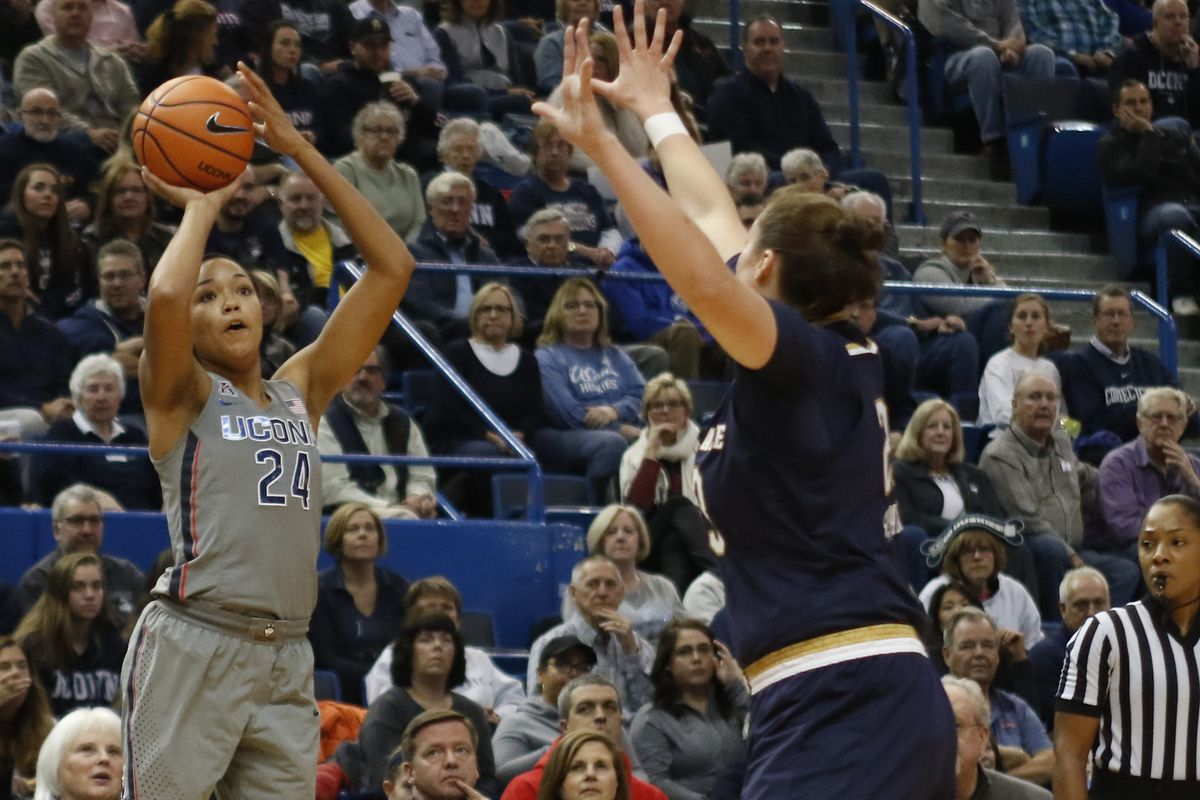 UConn�s Napheesa Collier (24) attempts a three-pointer over /Notre Dame's Jessica Shepard (23) during the Notre Dame Fighting Irish vs UConn Huskies women's college basketball game in the Women's Jimmy V Classic at the XL Center in Hartford, CT on December 3, 2017.