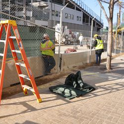 Workers replacing the fences along the Sheffield curb