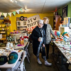 Francoise Wolfe [left] and JoEllen Wolicki peruse the items for sale in the thrift store section at Home Grown.
