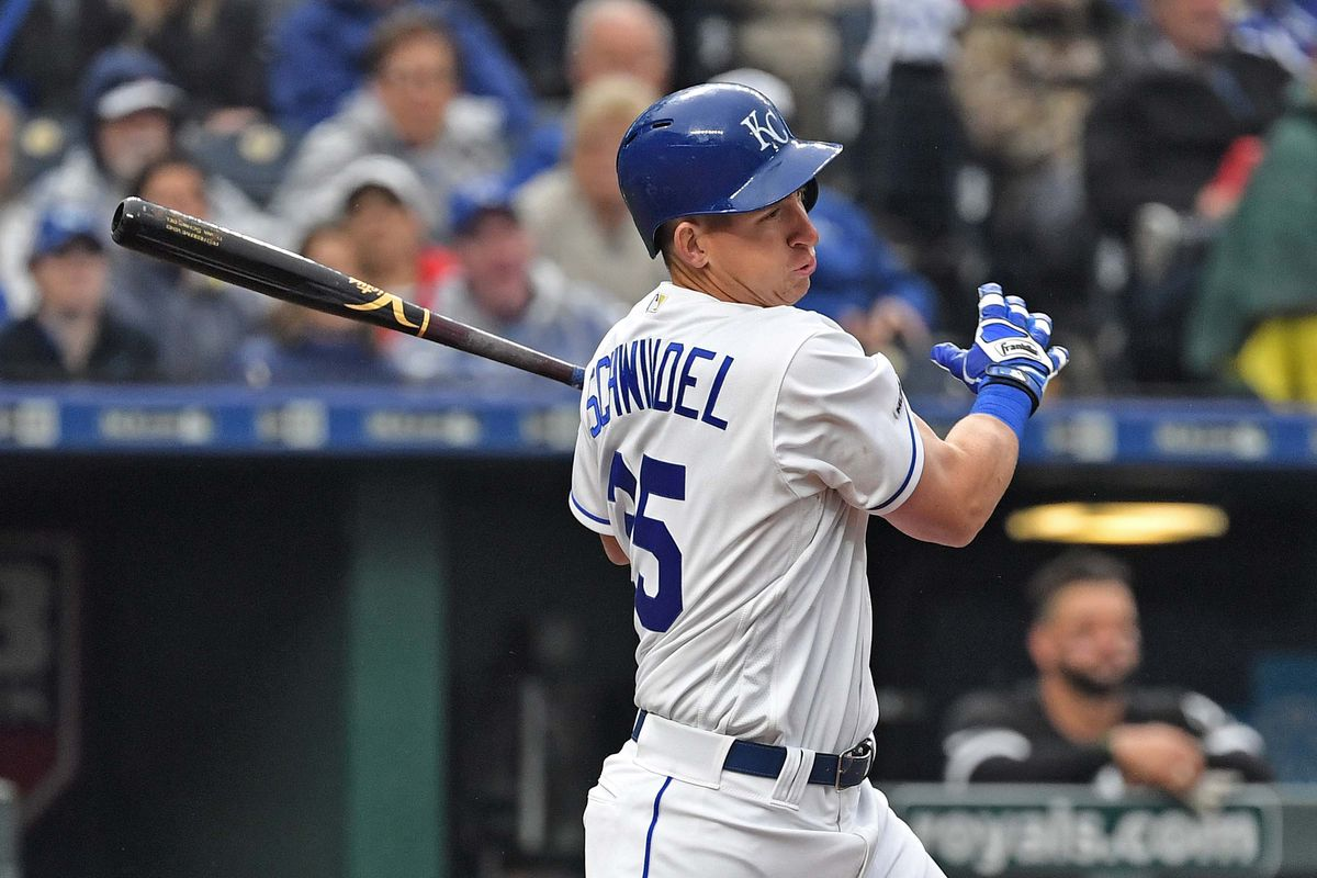 Kansas City Royals first baseman Frank Schwindel (25) singles in a run during the sixth inning against the Chicago White Sox at Kauffman Stadium.