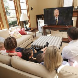 Tyler and Sheree Godfrey watch the 190th Annual General Conference of The Church of Jesus Christ of Latter-day Saints with their children Boston, Maddy, Gracie, Noah and T.J. from their home in Holladay on Saturday, April 4, 2020.