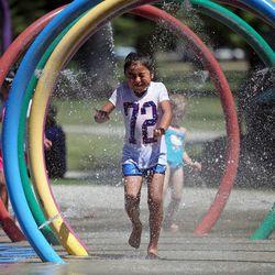 Mareya Avila plays in the splash pad at Liberty Park in Salt Lake City on Monday, June 19, 2017.