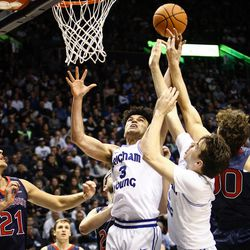 Brigham Young Cougars guard Elijah Bryant (3) and guard Zac Seljaas (2) fight for a second-half rebound with Saint Mary's Tanner Krebs (00) and center Evan Fitzner (21) as the BYU Cougars take on the Saint Mary's Gaels in the Marriott Center in Provo on Saturday, Dec. 30, 2017.