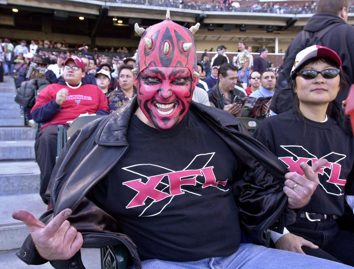 San Francisco Demons fan shows off his XFL shirt during a game against the Los Angeles Xtreme, circa 2001.