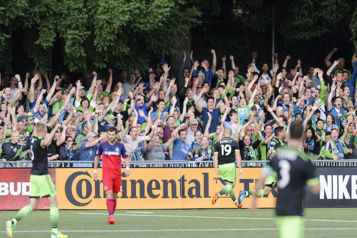 Former Fire man Chad Barrett celebrates his opener in front of Seattle supporters howling for more. They'd get it.