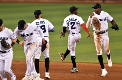 Miami Marlins outfielder Lewis Brinson, right, and second baseman Jazz Chisholm Jr. (2) celebrate a win over the Baltimore Orioles at loanDepot Park.