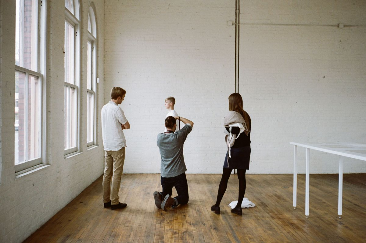 A model, photographer, and two other people at an Ouur Collection lookbook shoot