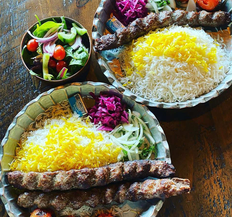 Two kebabs over saffron rice
