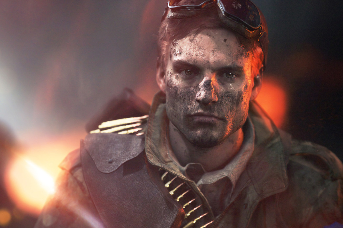 A dirty man with goggles raised walks toward the camera in key art for Battlefield 5.