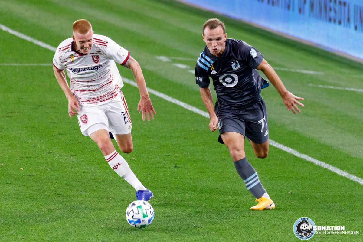 September 6, 2020 - Saint Paul, Minnesota, United States - Real Salt Lake defender Justen Glad (15) and Minnesota United defender Chase Gasper (77) chase down the ball during the match at Allianz Field.