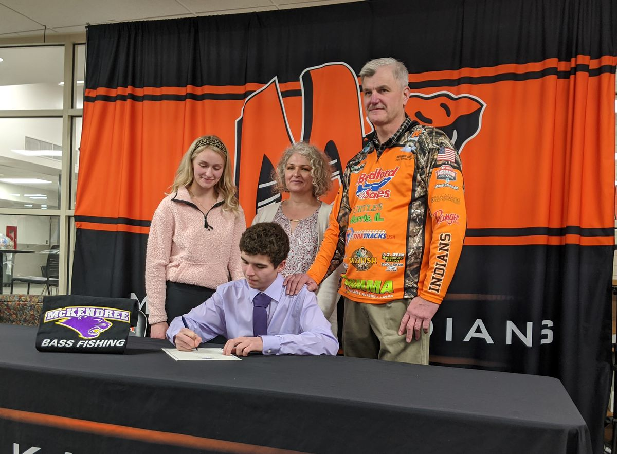 Minooka senior Wyatt Pazdro, shown here with his family signing a letter of intent for McKendree University, will not have the chance to be the rare angler to make the state finals for bass fishing all four years because of the cancellation by the IHSA of all tournaments for spring sports and activities. Credit: Dale Bowman