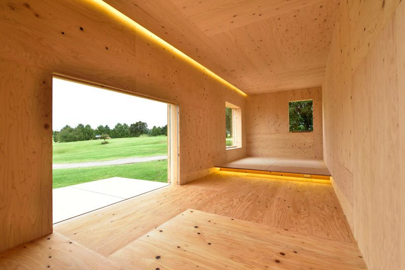 The inside of Kuma's mobile home, which is covered in wood panelling.