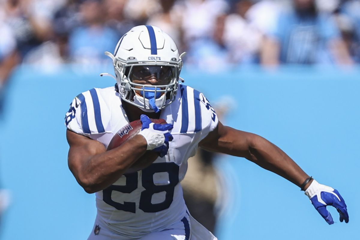 Jonathan Taylor #28 of the Indianapolis Colts runs the ball against the Tennessee Titans at Nissan Stadium on September 26, 2021 in Nashville, Tennessee.