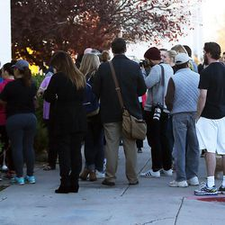 Parents wait to pick up students at Mountain View High School in Orem on Tuesday, Nov. 15, 2016, after five students were stabbed in an apparent attack by a 16-year-old boy.