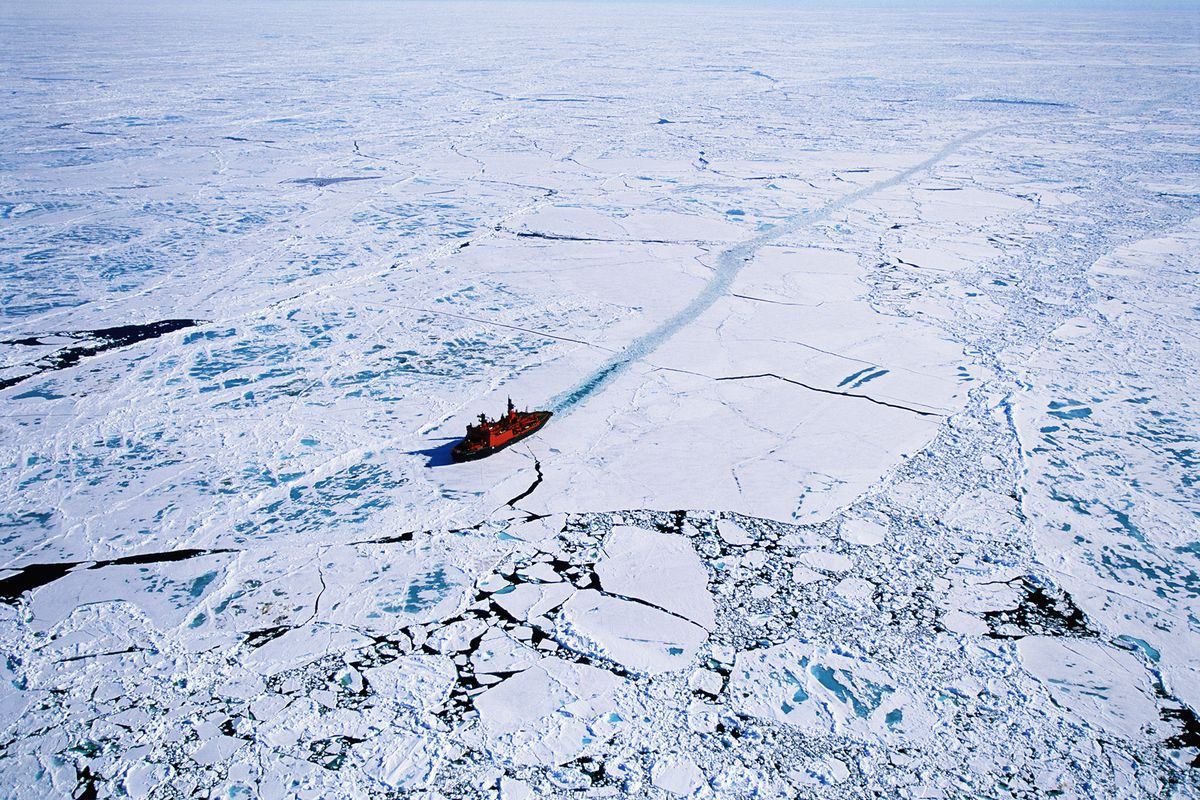 An aerial view of a Russian nuclear icebreaker clearing a path in ice to North Pole