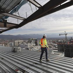 Sean Tuite, Director of Construction for City Creek Reserve, looks over continuing construction at 95 State at City Creek in Salt Lake City on Wednesday, Nov. 25, 2020. The 515,000-square-foot 25-story Class A office tower will feature cutting-edge technology incorporating state-of-the-art enhancements that allows touchless entry from the main door and throughout the property, thereby creating a safer and healthier workplace experience for tenants and visitors.