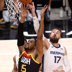 Utah Jazz center Derrick Favors (15) battles with Memphis Grizzlies center Jonas Valanciunas (17) for the ball as the Utah Jazz and the Memphis Grizzlies play in game 5 at Vivint Arena in Salt Lake City on Wednesday, June 2, 2021. Utah won 126-110, Utah advances to the second round.