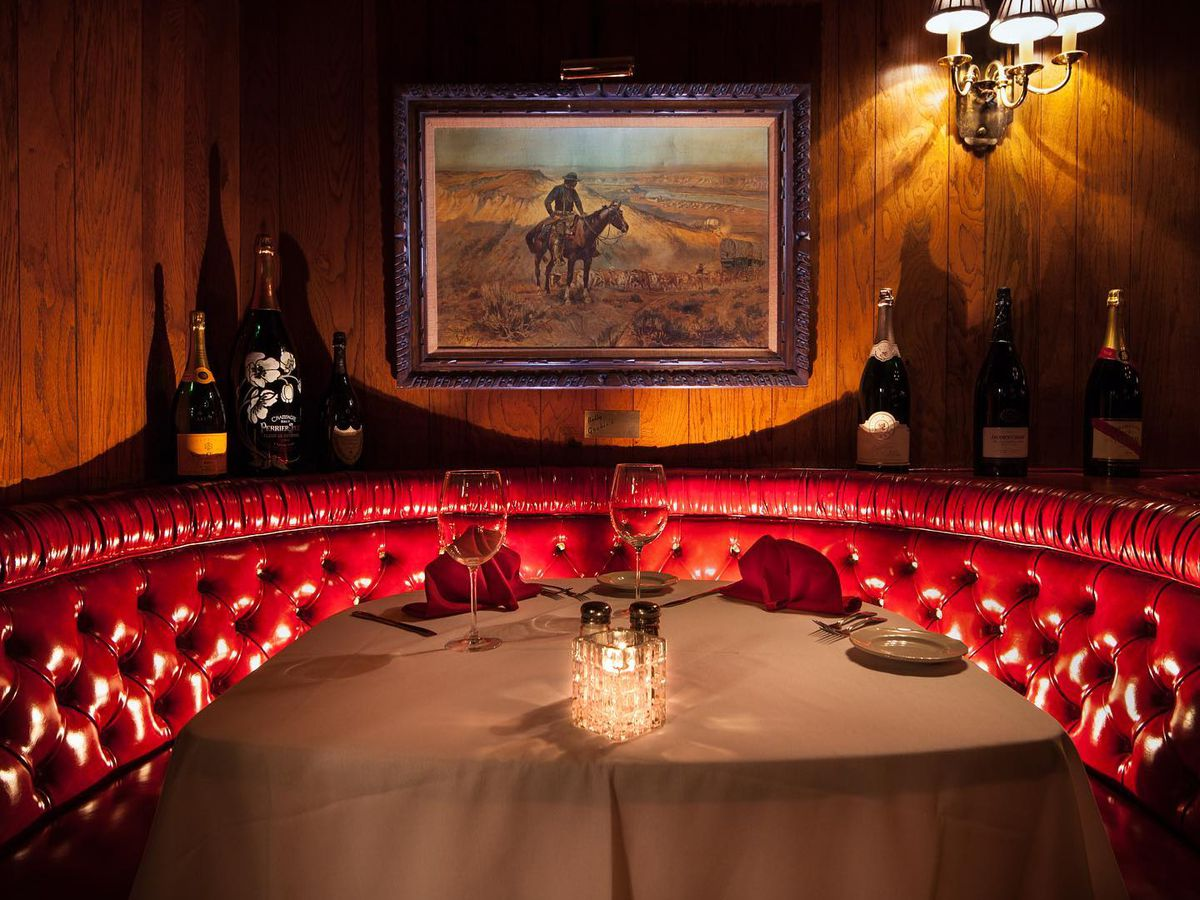A red leather booth inside a steakhouse