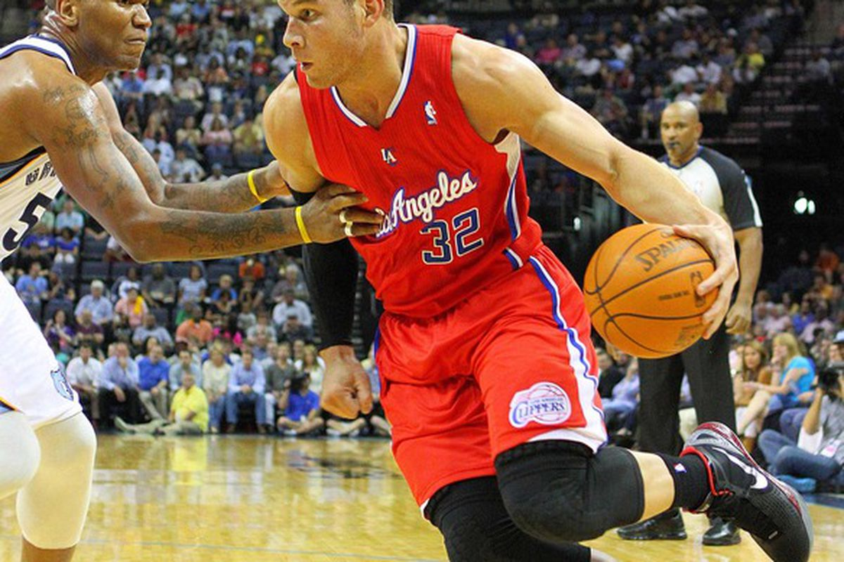Apr 9, 2012; Memphis, TN, USA;  Los Angeles Clippers power forward Blake Griffin (32) drives to the basket against Memphis Grizzlies center Marreese Speights (5) during the first half at the FedEx Forum.  Mandatory Credit: Spruce Derden-US PRESSWIRE