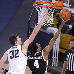 Nevada guard Desmond Cambridge Jr. (4) takes a shot as Utah State center Trevin Dorius (32) defends during the first half of an NCAA college basketball game Sunday, Feb. 28, 2021, in Logan, Utah.
