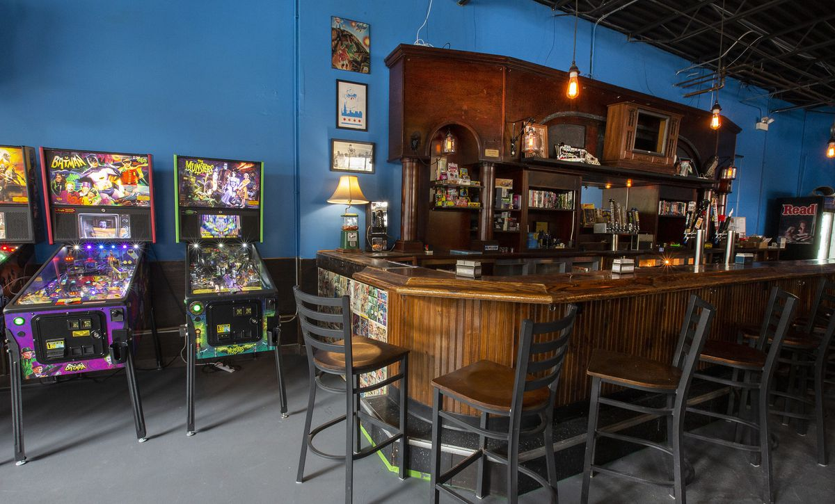 a bar and pinball machines