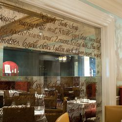 Folse and Tramonto's turtle soup recipe, on a wall dividing one dining room from the bar.