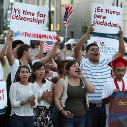 Participants march during a vigil for immigration reform in Salt Lake City, Thursday, June 27, 2013.