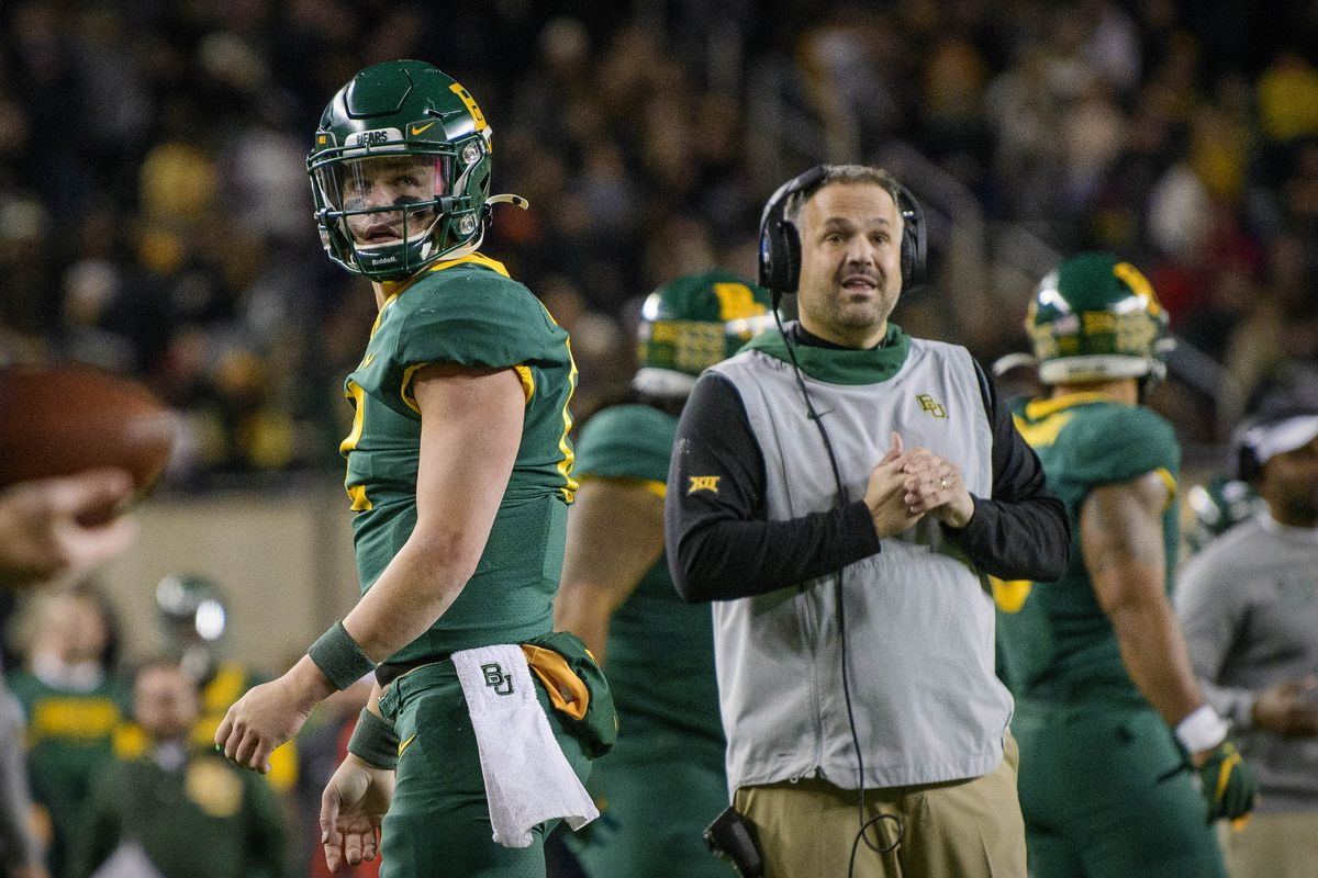 Baylor Bears quarterback Charlie Brewer and Baylor Bears head coach Matt Rhule check out the replay board after Brewer is stopped short on a fourth down attempt against the West Virginia Mountaineers during the second quarter at McLane Stadium.