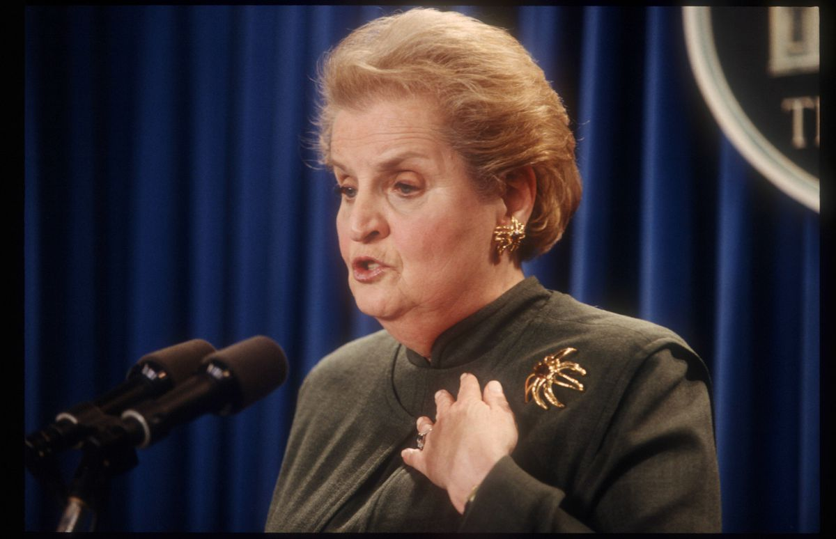 Secretary of State Madeleine Albright at a briefing in 1998, adorned with a golden crab brooch.