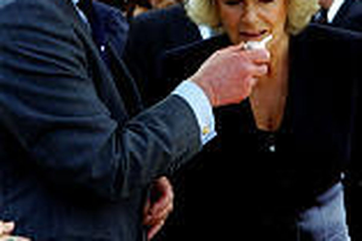 Britain's Prince Charles and Camilla, Duchess of Cornwall, sample organic foods at a farmers market in Point Reyes Station, Calif., on Saturday.