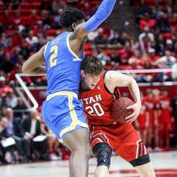 Utah Utes forward Mikael Jantunen (20) drives against UCLA Bruins forward Cody Riley (2) during the basketball game at the Jon M. Huntsman Center in Salt Lake City on Thursday, Feb. 20, 2020.