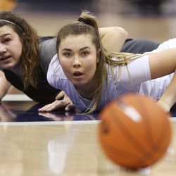 Brigham Young Cougars guard Shaylee Gonzales (2). And Pepperdine Waves guard Rose Pflug (2) fight for the ball in Provo on Thursday, Jan. 3, 2019.
