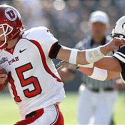 Ute quarterback Brett Ratliff is chased out of bounds by BYU's Spencer White.
