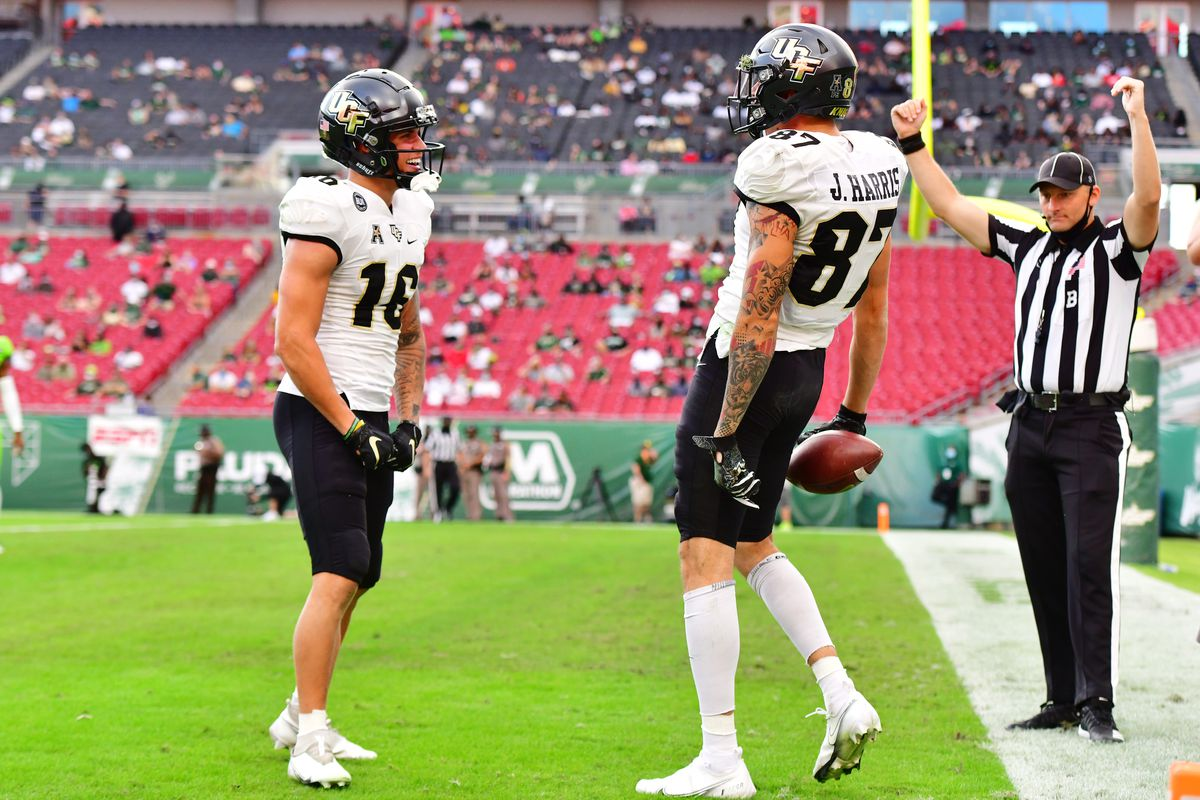 Tre Nixon #16 celebrates with Jacob Harris #87 of the UCF Knights after a touchdown during the first half at Raymond James Stadium on November 27, 2020 in Tampa, Florida.