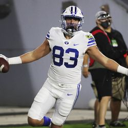 Brigham Young Cougars tight end Isaac Rex (83) scores against the UCF Knights during the Boca Raton Bowl in Boca Raton, Fla., on Tuesday, Dec. 22, 2020.