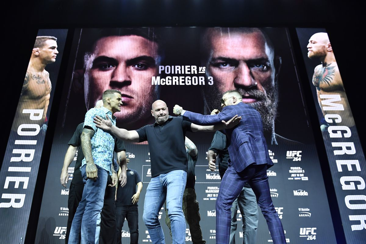 Dustin Poirier and Conor McGregor face off during the UFC 264 press conference