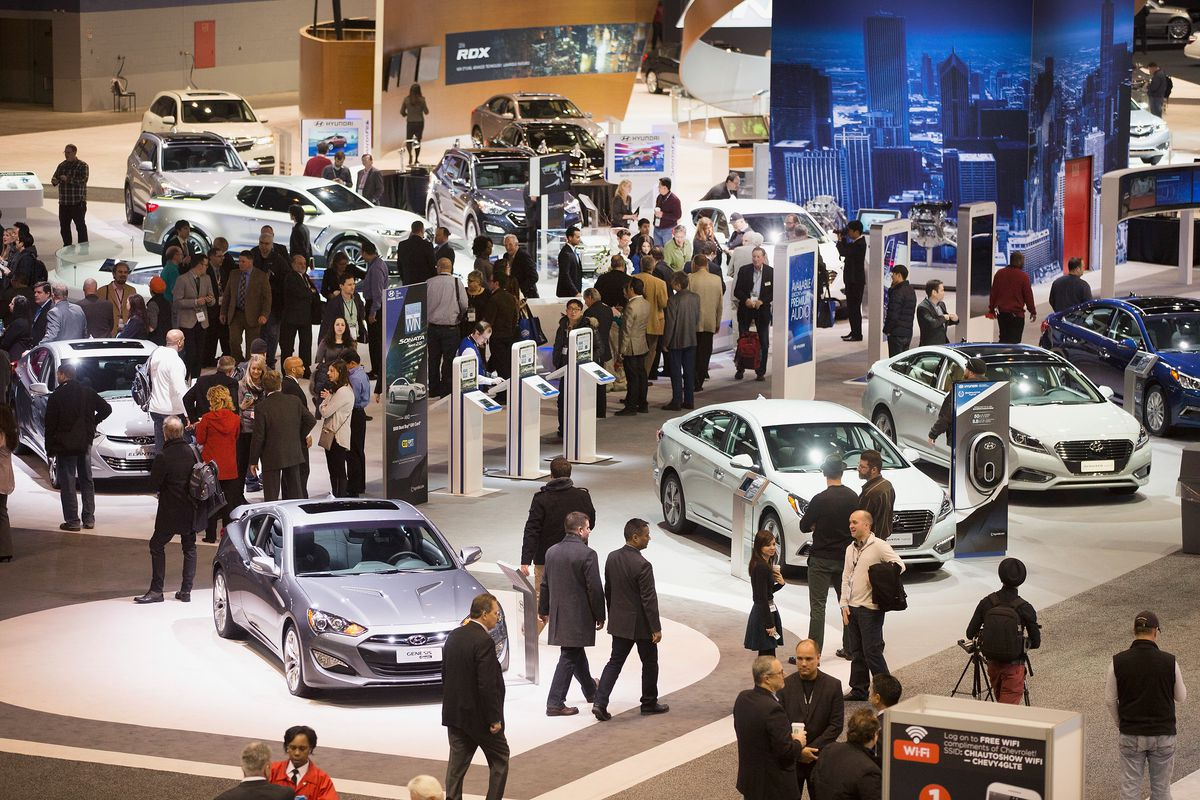 Guests look over cars at the 2015 Chicago Auto Show during the media preview.   Scott Olson/Getty Images