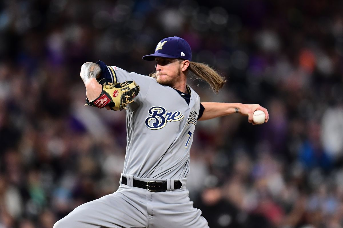Milwaukee Brewers relief pitcher Josh Hader delivers a pitch in the ninth inning against the Colorado Rockies at Coors Field.