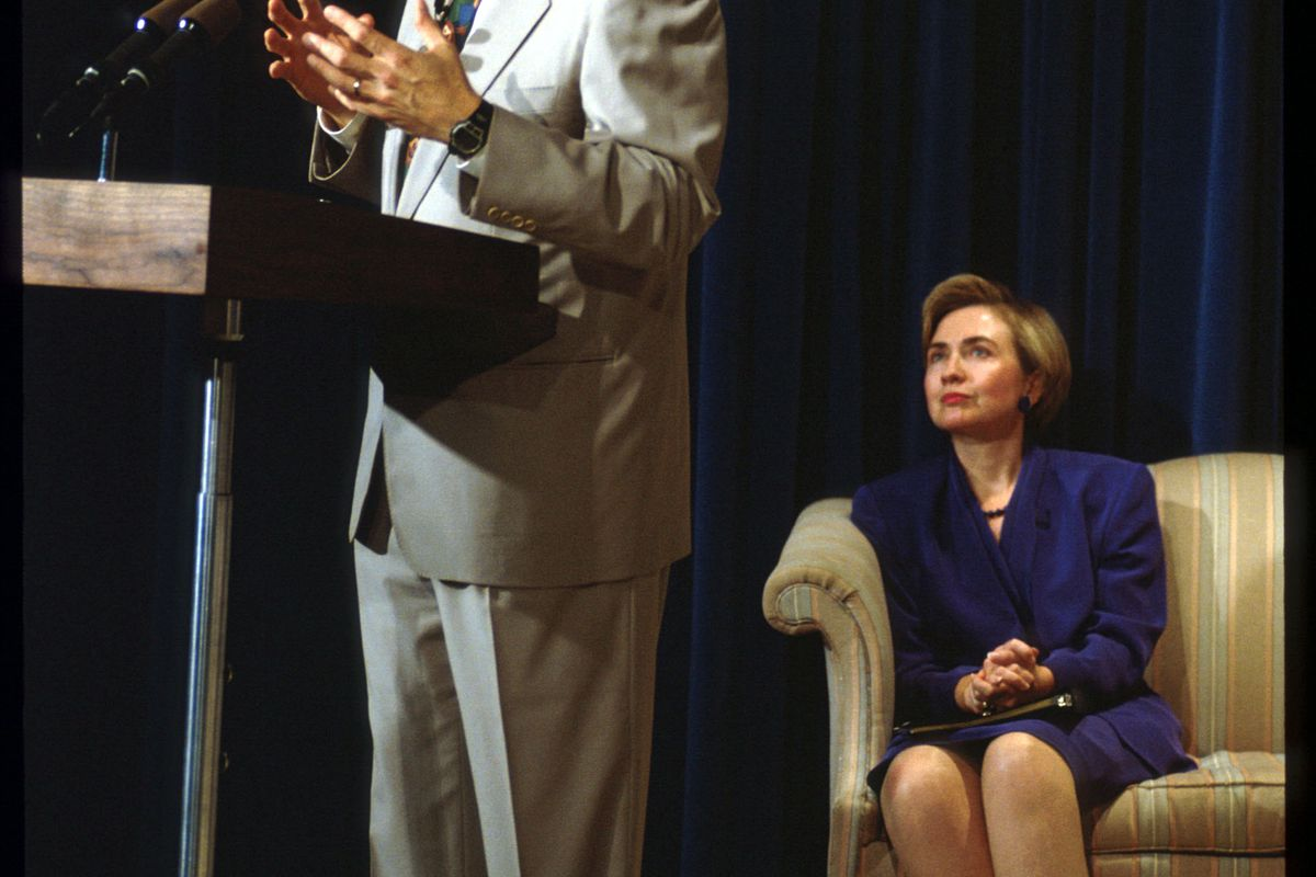 Hillary Clinton watches Bill Clinton speak during a 1993 MTV forum on crime.