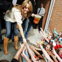 """Miley Cyrus greets her fans in back of the Megaplex 20 in South Jordan, where she made an appearance Friday for the premiere of her movie, """"Hannah Montana."""""""