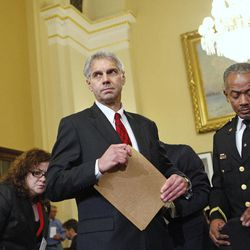 FILE - In this Thursday, Dec. 3, 2009 file photo, Secret Service Director Mark Sullivan, left, arrives on Capitol Hill in Washington to testify before the House Homeland Security Committee hearing on a White House security breach. At right is Curtis B. Eldridge Jr., chief of the United States Secret Service Uniformed Division. The Secret Service has been tarnished by a prostitution scandal that erupted April 13, 2012 in Colombia involving 12 Secret Service agents, officers and supervisors and 12 more enlisted military personnel ahead of President Barack Obama's visit there for the Summit of the Americas.