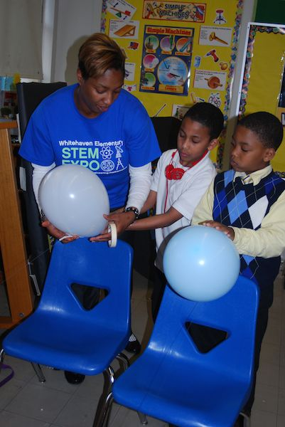 Whitehaven Elementary fifth grade science teacher Amanda Gary works with two students on an experiment called 'Rocket Launch.'