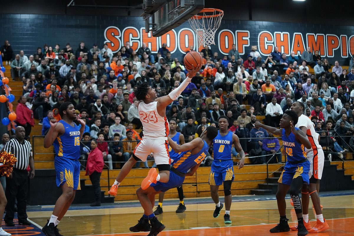 Young's Tyler Beard (24) gets a reverse layup against Simeon.