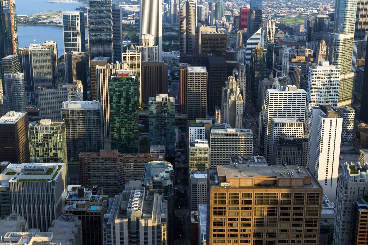 A group of downtown high-rise buildings from an aerial perspective.
