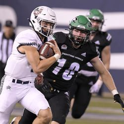 Utah State quarterback Andrew Peasley (6) runs down the field for a 59-yard touchdown as North Dakota linebacker Caden White (10) chases after him during the second half of an NCAA college football game Friday, Sept. 10, 2021, in Logan, Utah.
