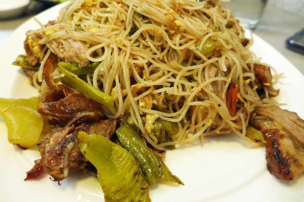Fine white rice noodles tossed with boneless duck, skin on.