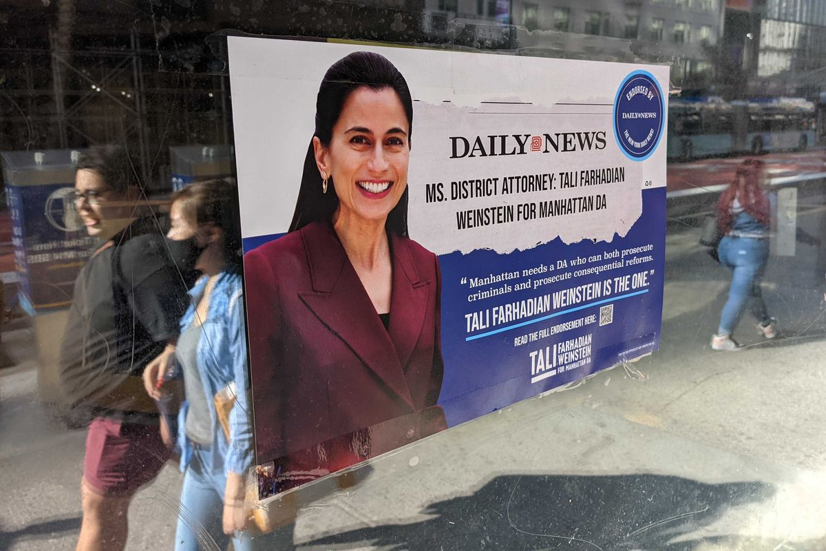 A campaign poster for Manhattan DA candidate Tali Farhadian Weinstein hangs on an empty storefront window on 14th Street, June 14, 2021.