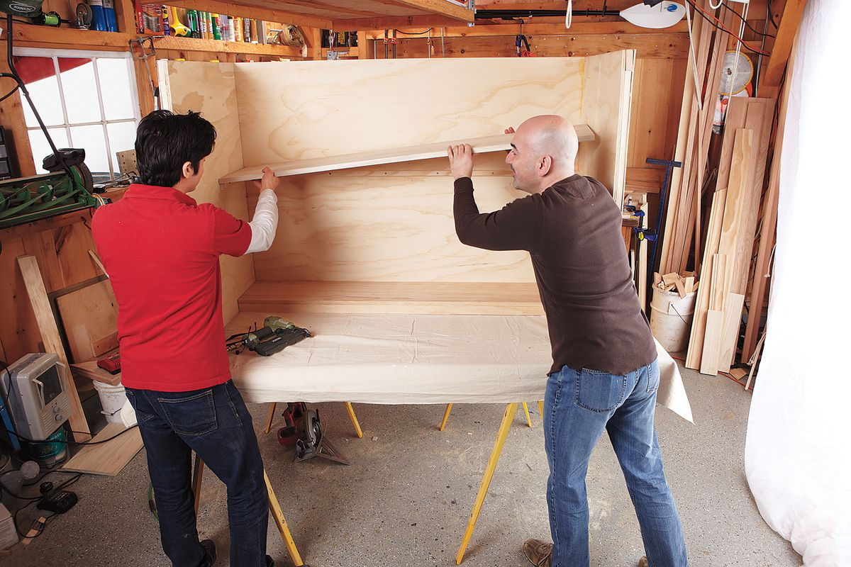 Men Adding Shelves To DIY Home Bar